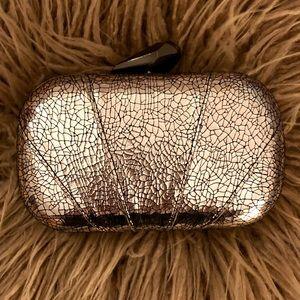Handbags - Limited edition silver animal print clutch w/chain